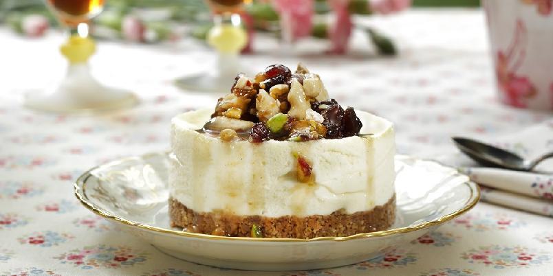 Ostekake med nøttetopping - Deilig nøttevri på en glutenfri ostekake...